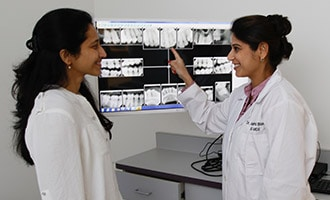Dr. Bhave showing patient x-rays