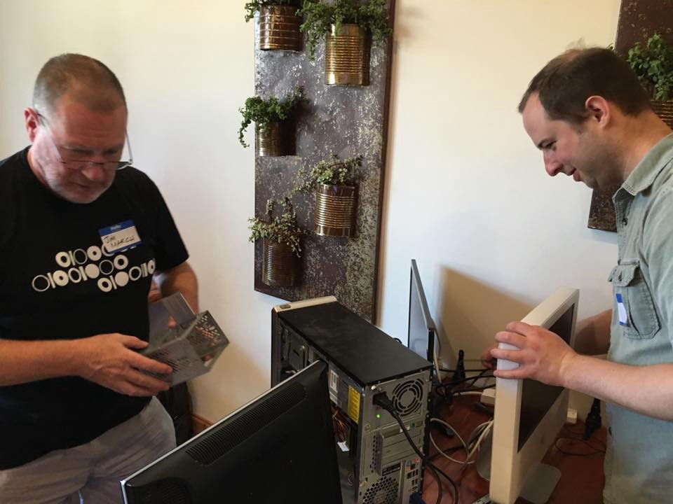 <p>Code for Asheville Volunteers repair computers that were later donated to homeless advocacy organization BeLoved.</p>