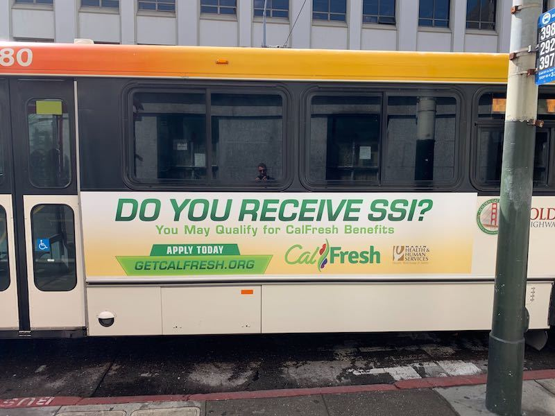 "Bus with slogan, ""Do you receive SSI?"""