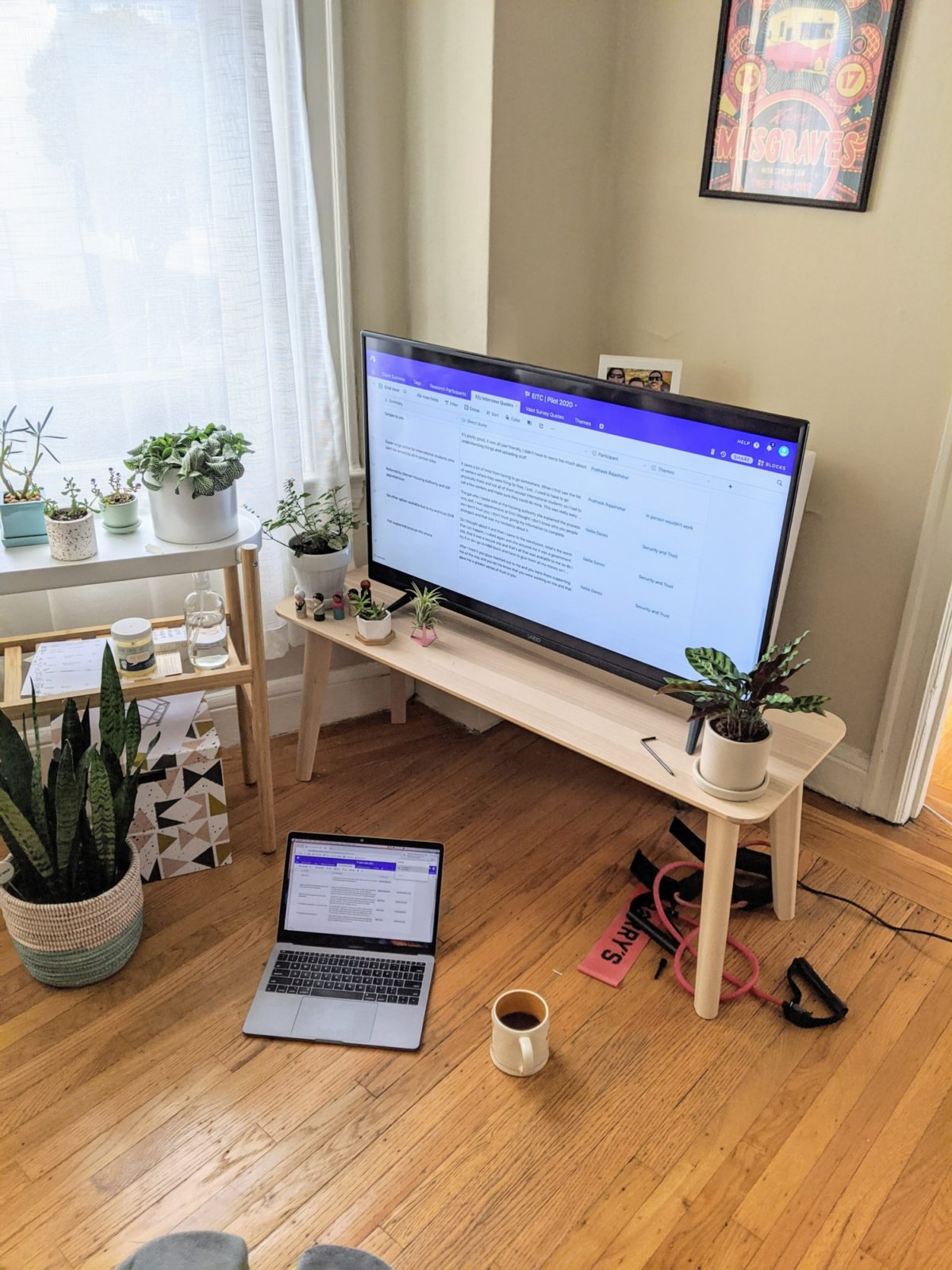 Airtable screen on a computer and TV