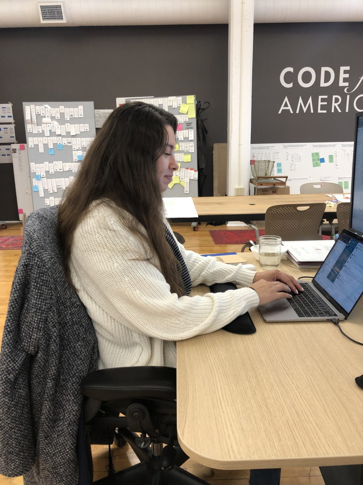 Atzay sitting at her desk in Code for America's office
