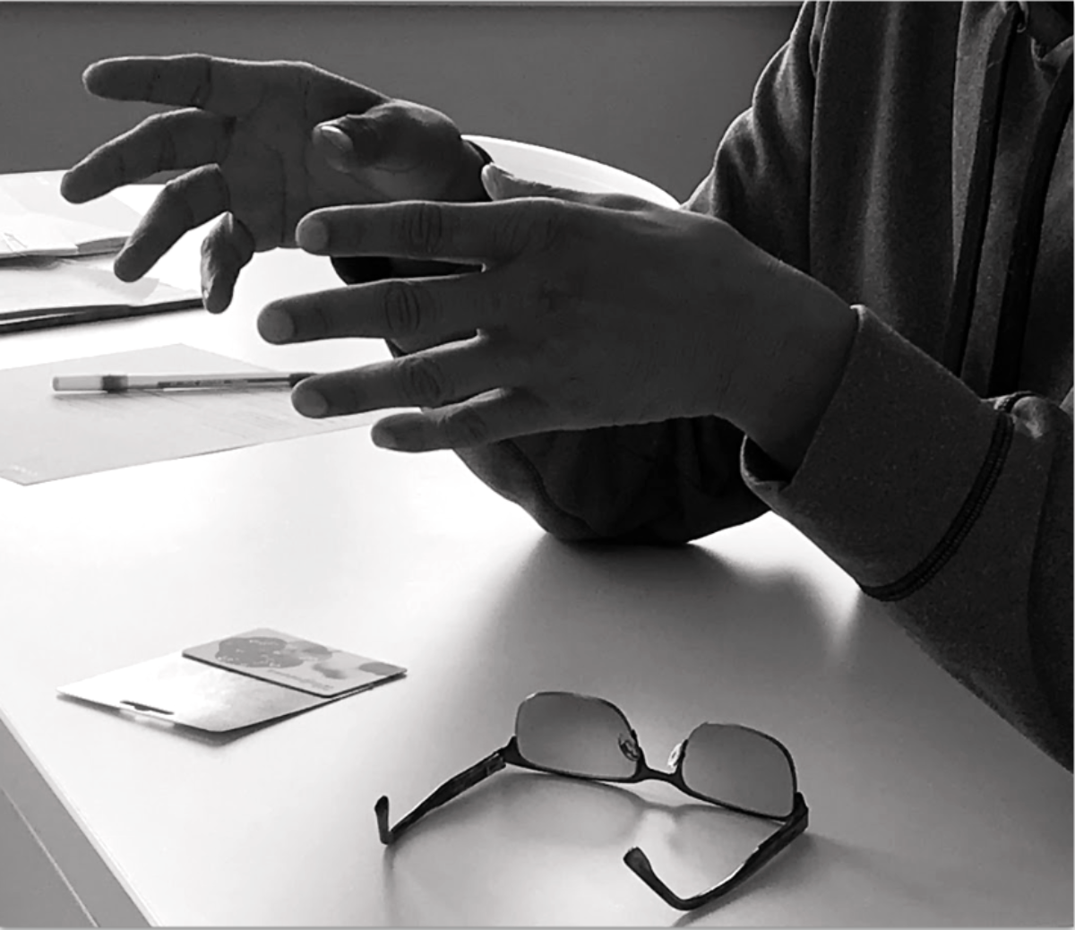 A client's hands over a table