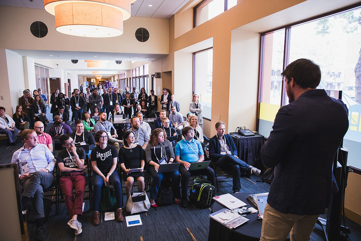 People listening to a Lightning Talk at the 2019 Code for America Summit