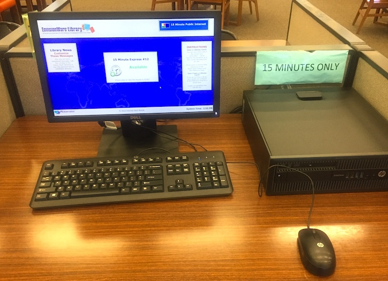 library computer station with a sign that says 15 minutes