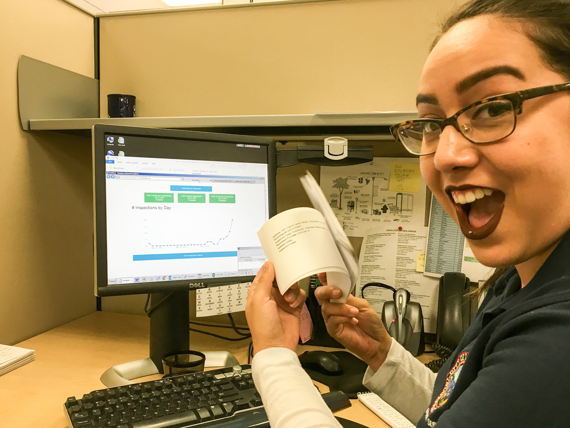 <p>Permit Technician Sabrina G. showing off the new inspections requests</p>