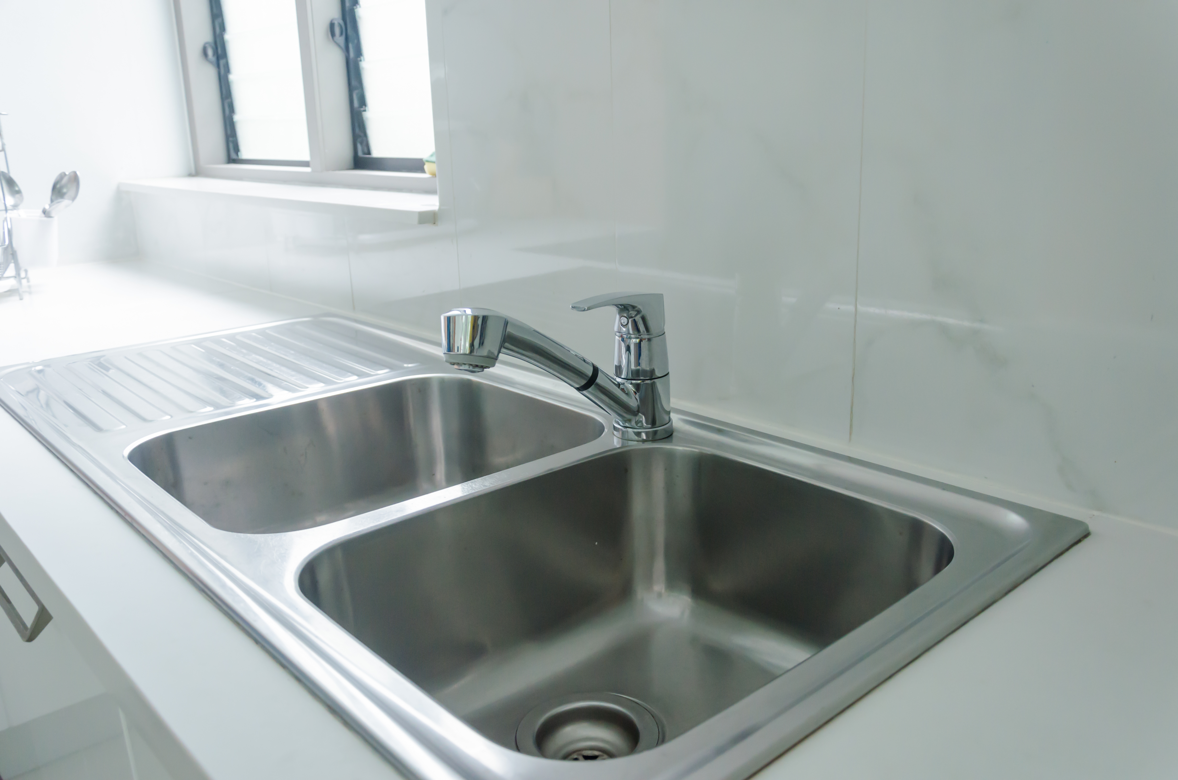 How to Fix a Slow-Draining Kitchen Sink