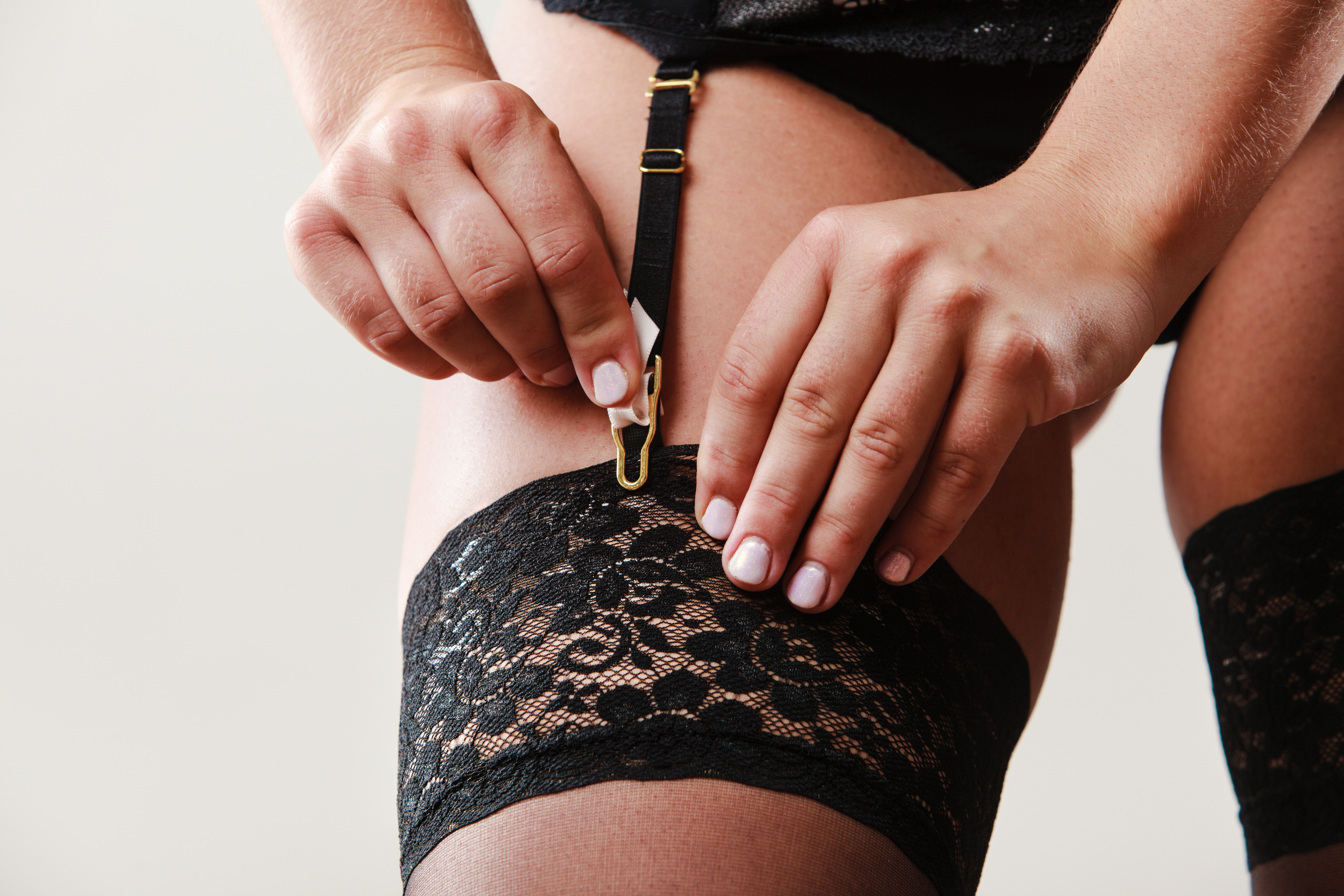 edc48ab6f2a How to Attach Thigh Highs to a Garter Belt | LEAFtv