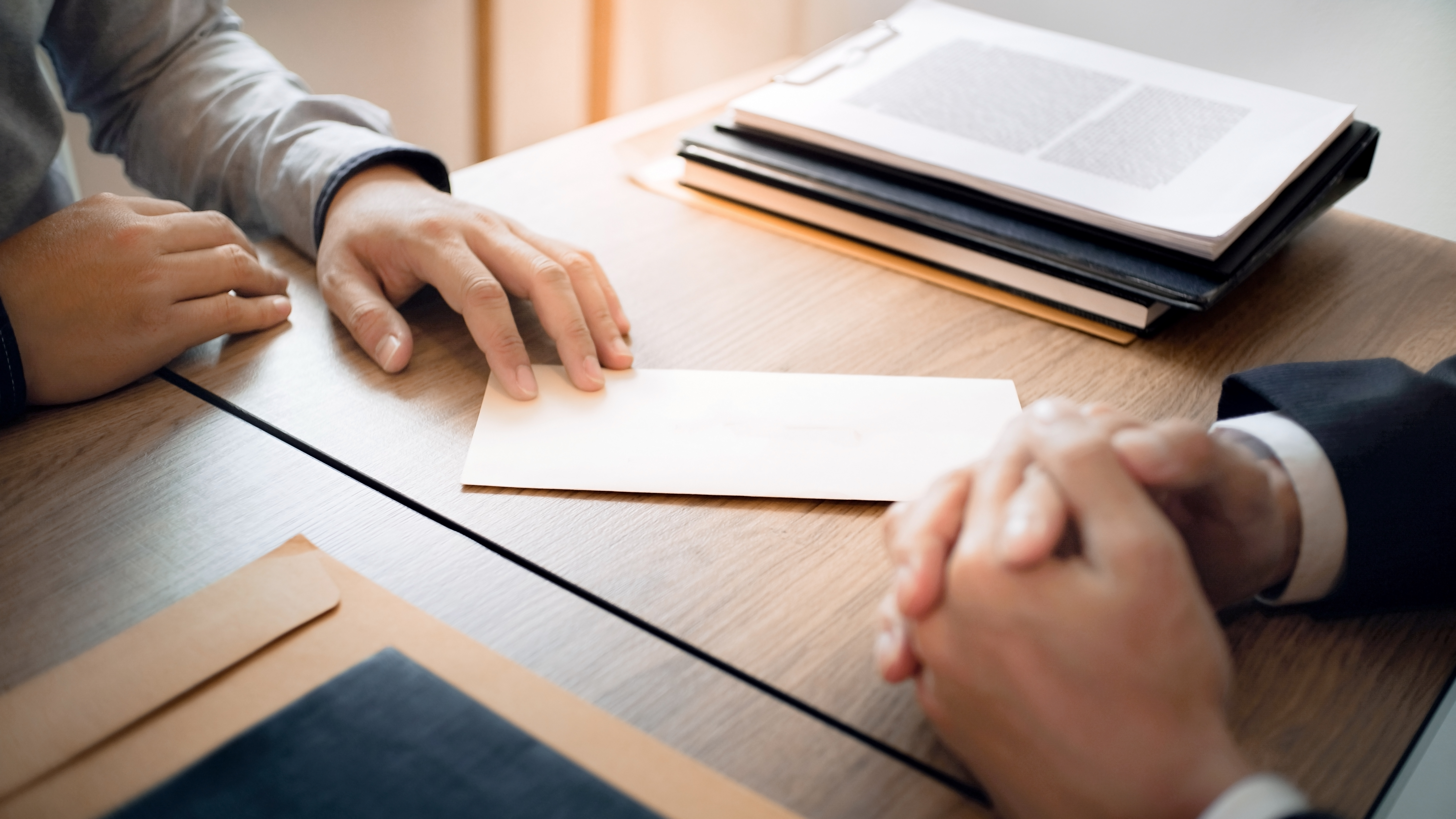 How to Terminate an Employee Contract Due to Closing of