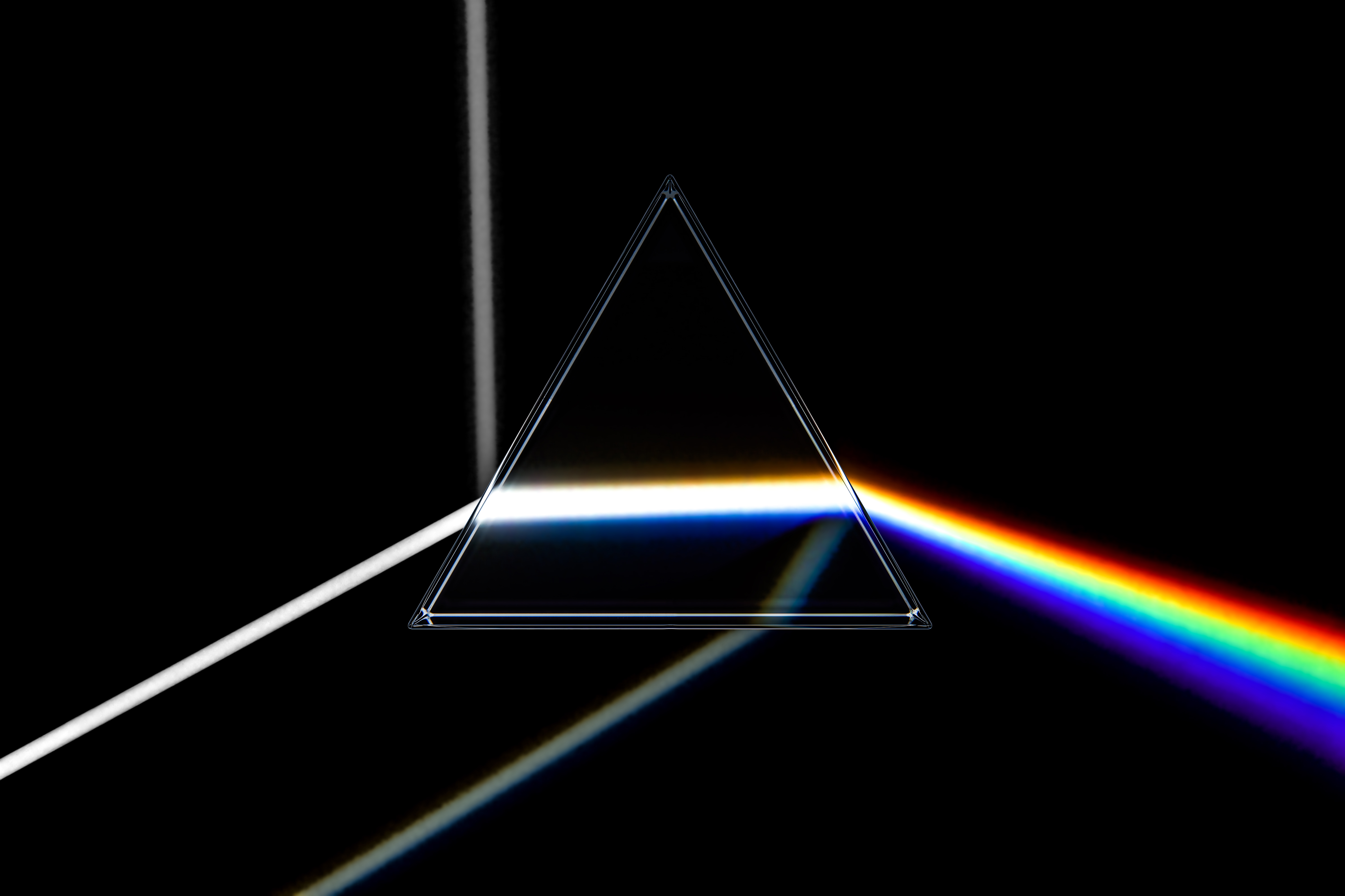 What Happens to a White Light When It Passes Through a Prism and Why?