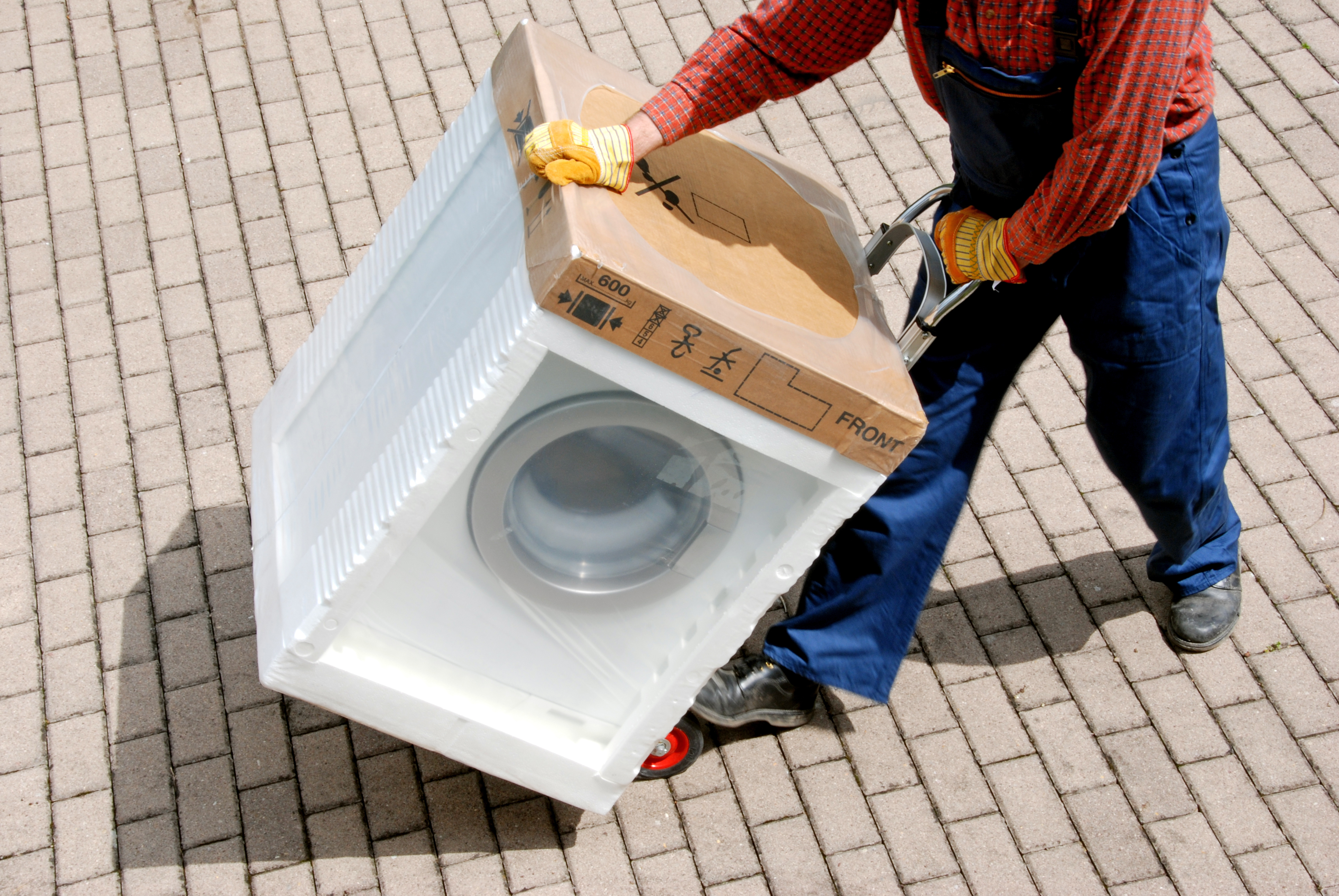Can a Washing Machine Be Transported on Its Back? | Hunker