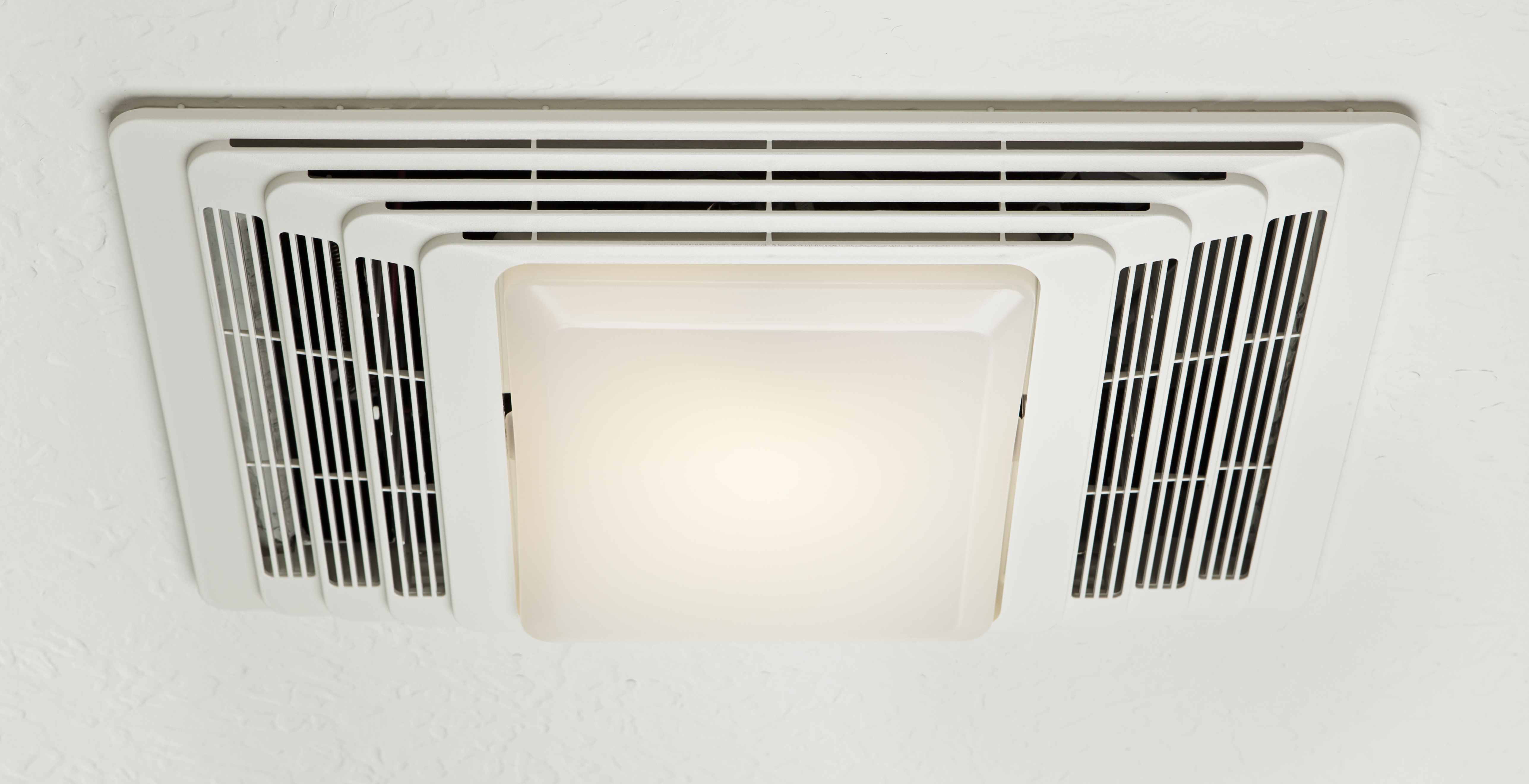 How To Replace A Bathroom Exhaust Fan Light Bulb Hunker