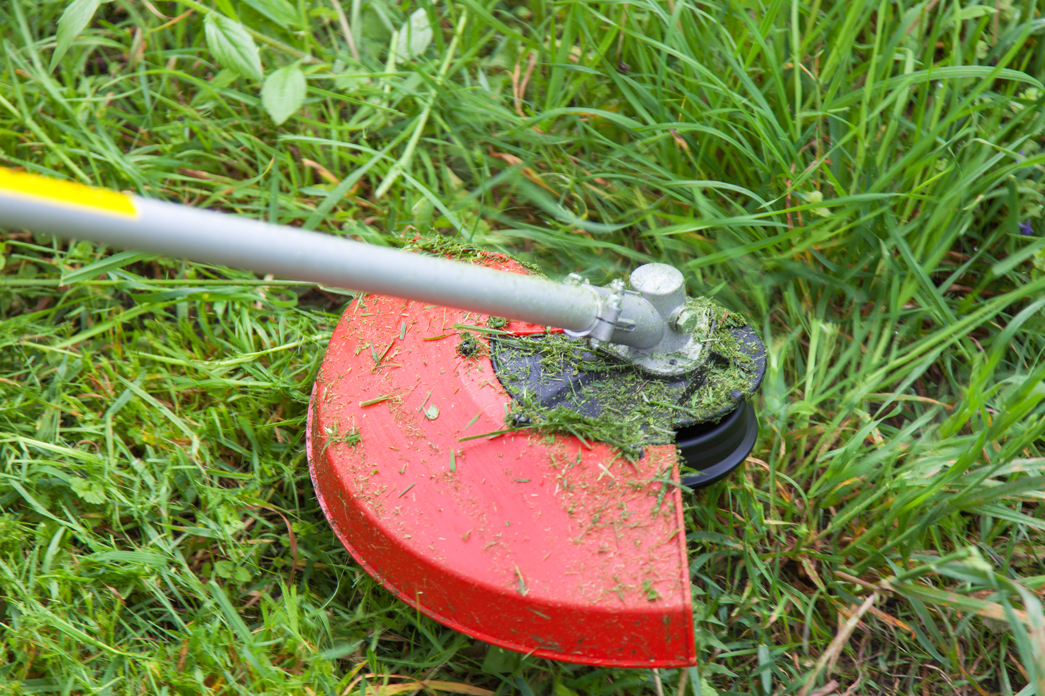 How to Remove a Ryobi Trimmer String Assembly | Home Guides