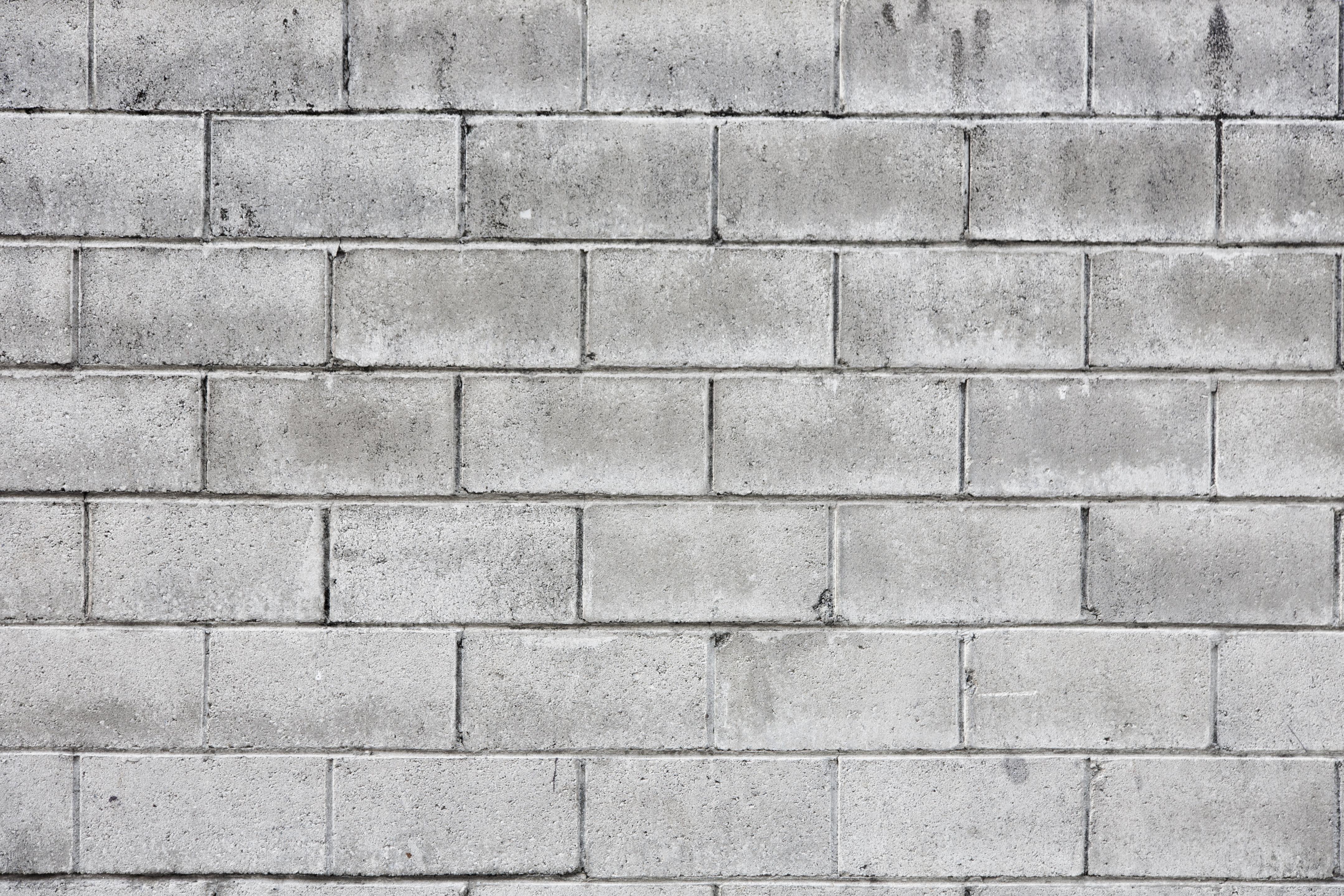 DIY Cinder Block Retaining Walls With Rebar and Concrete   Hunker