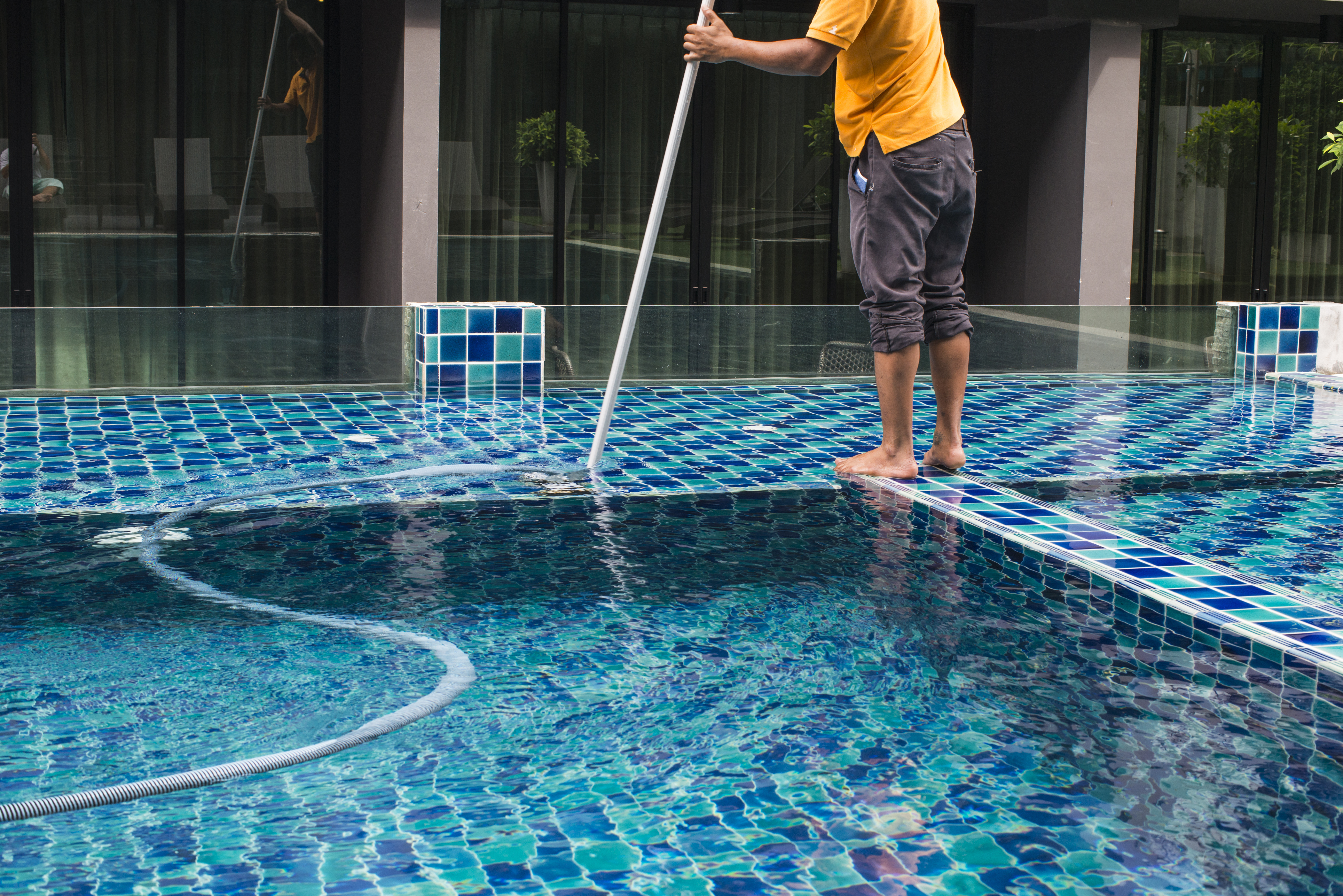 How to Vacuum a Pool to Direct Waste | Home Guides | SF Gate