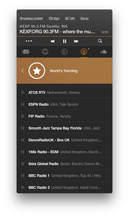 Spotify Web Player vs LOOP comparison: VOX Radio features real radio station from all over the world. 'World's Trending' tab is open
