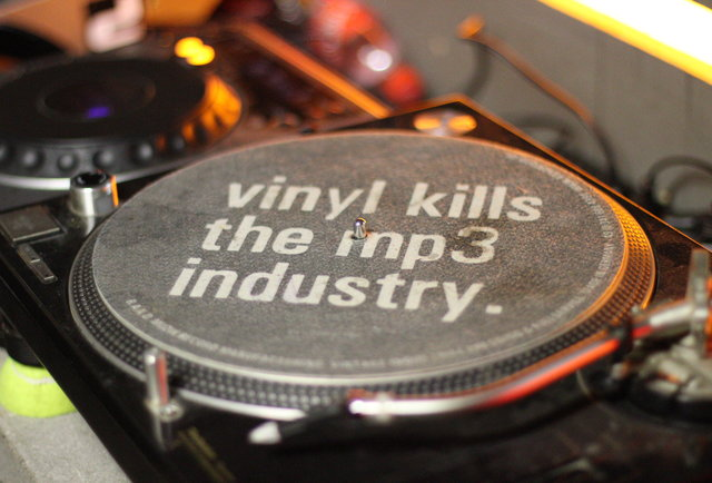 A vinyl record with 'vinyl kills the mp3 industry' written on it