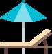 Open umbrella next to a lounger