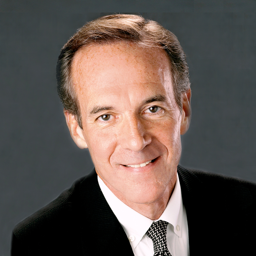 Head shot of Jim Fraser, brown haired man in a dark suit and tie