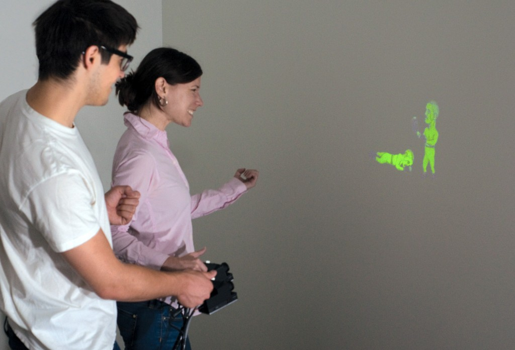 SideBySide- Ad-hoc Multi-user Interaction with Handheld Projectors-Image