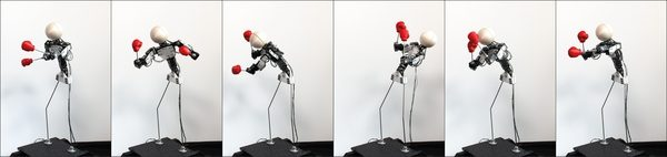 Vibration-Minimizing Motion Retargeting for Robotic Characters