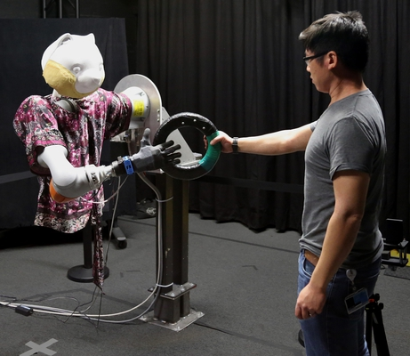 Fast Handovers with a Robot Character: Small Sensorimotor Delays Improve Perceived Qualities