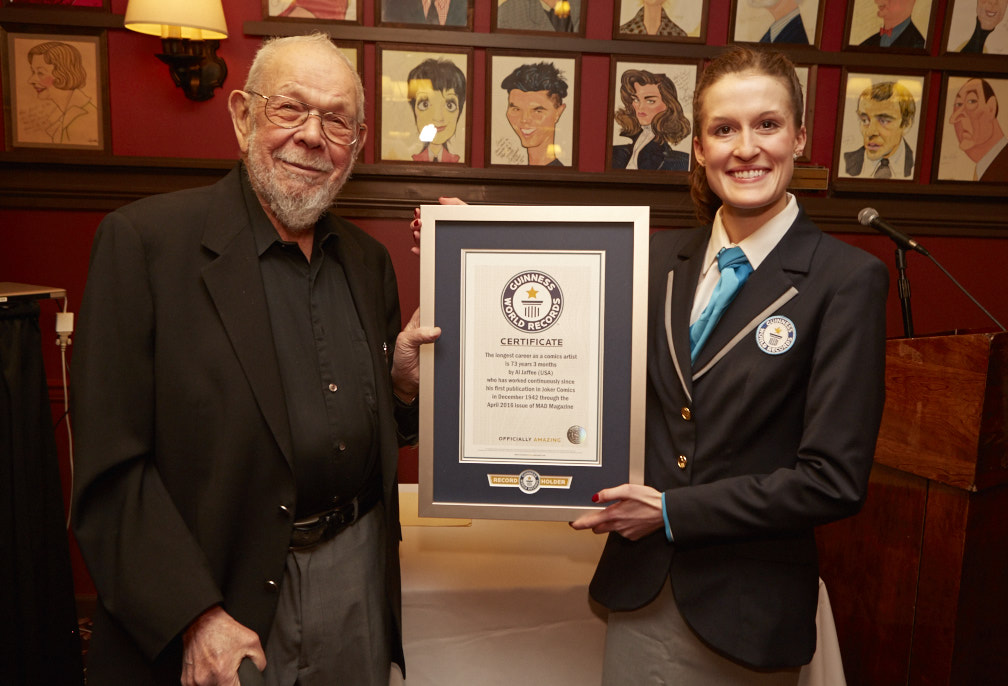 Al with Guinness World Records adjudicator Kellie Ferrick after Al received the Guinness World Record for having the longest career as a comics artist
