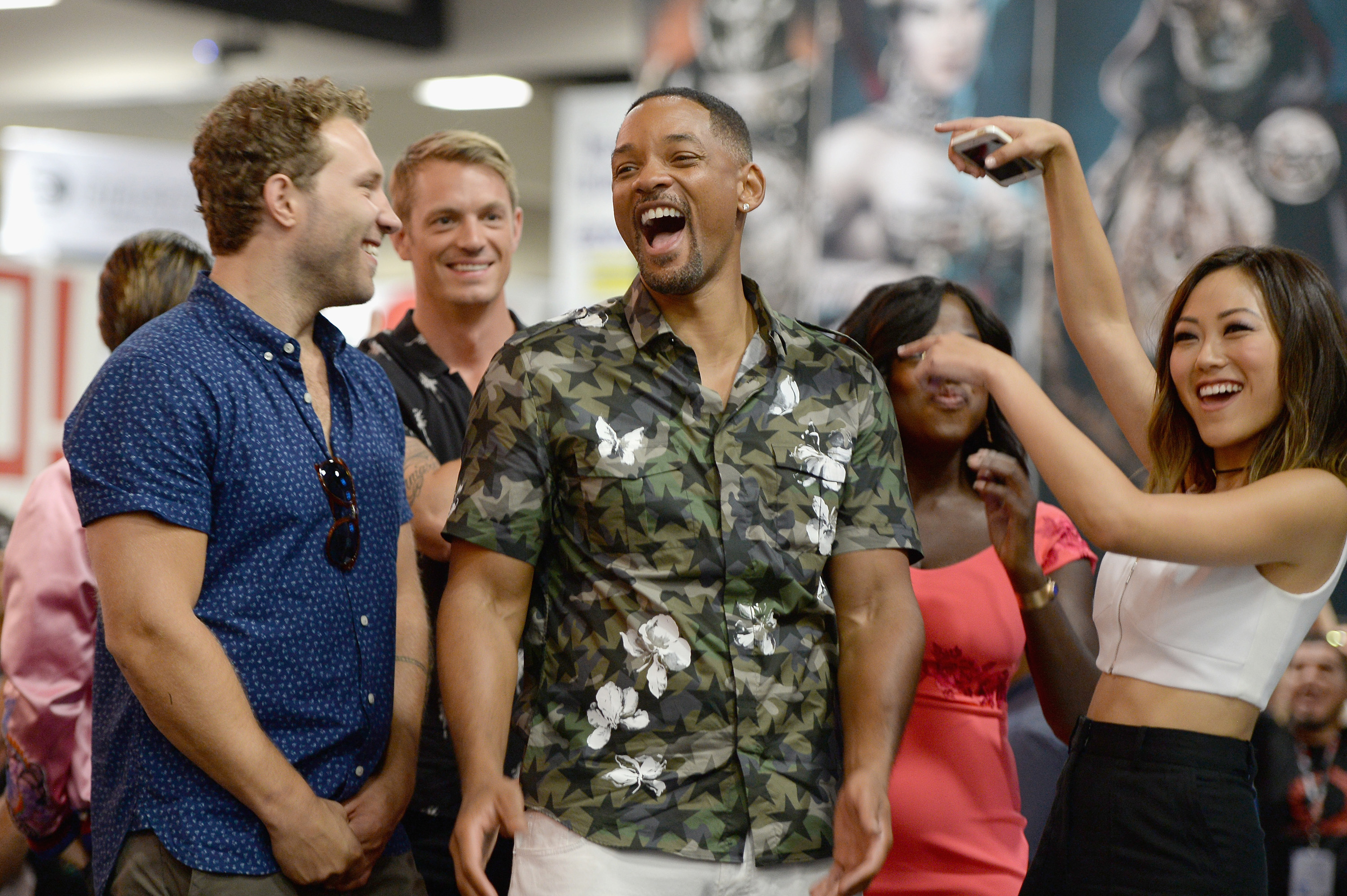 The cast of Suicide Squad participates in an autograph session for fans at DC's 2016 San Diego Comic-Con booth on Saturday, July 23
