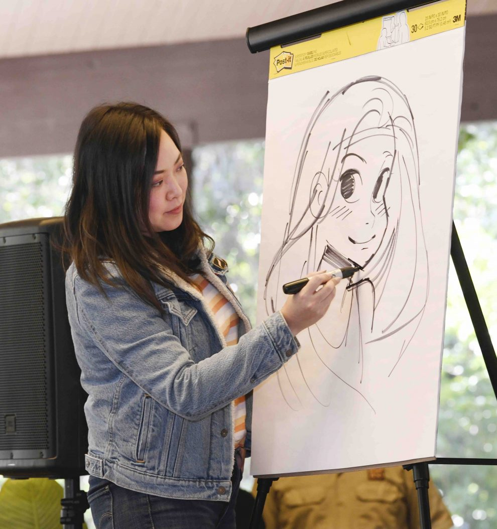 Ying demonstrating how to draw Wonder Woman