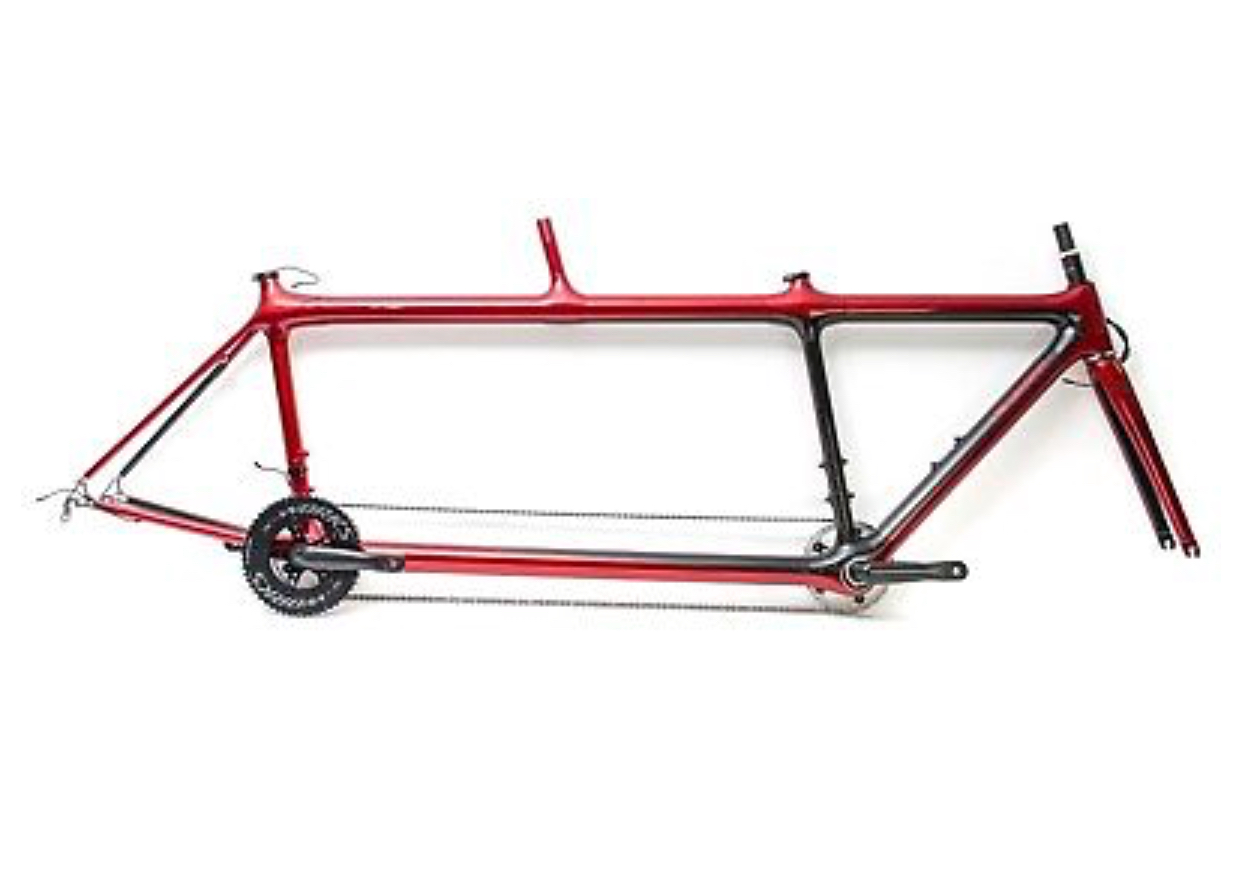 a Calfee tandem bicycle frame with no components attached. The frame is deep red with no decorations.