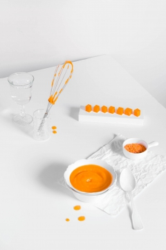 orange soup on white