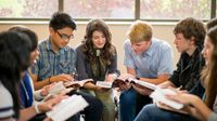 A group of high school students sitting in a circle, discussing a book