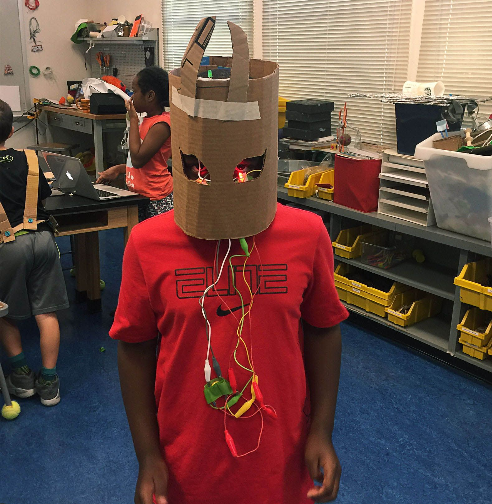 One of the author's students tries on a helmet.