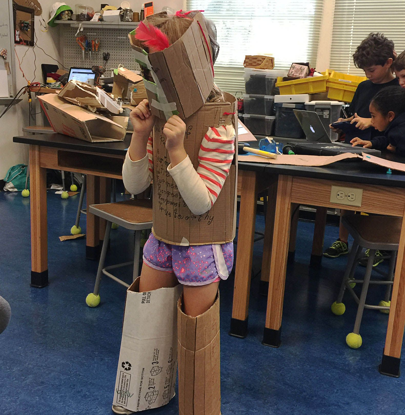 One of the writer's students tests out a suit of armor.