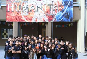 Senior mentors stand in front of Humanitas Social Justice Academy.