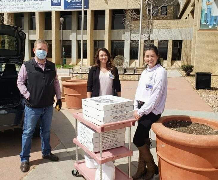 City Councilor Zach Urban delivers pizzas to staff at Lutheran Medical Center