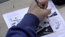 Student writing a comic