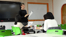 Teacher teaching reading to ESL students