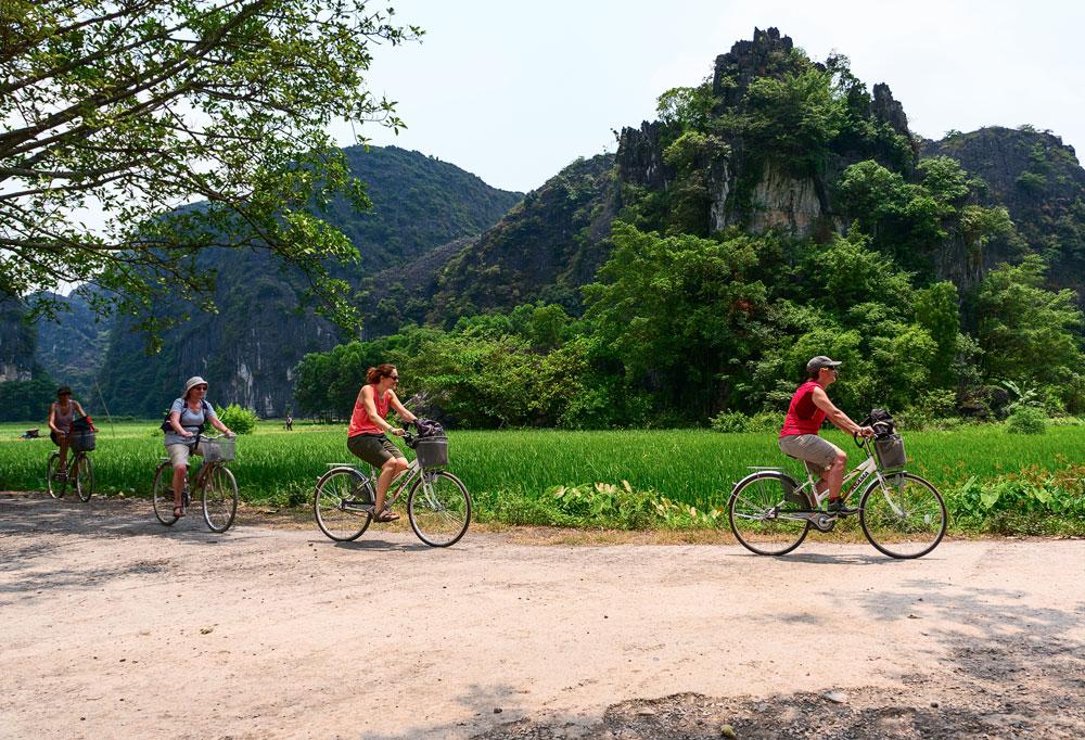TRANG AN, VIETNAM, tourist groups, cycling picnic, scenic natural area Trang An, Ninh Binh Province, Vietnam