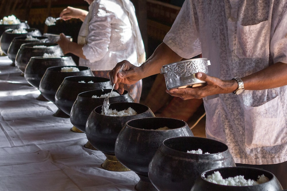 People offer rice at a local monastery in Kompong Cham, Cambodia, during Virak Wanabat, the second day of Khmer New Year