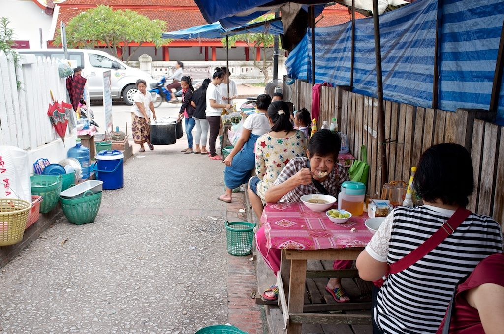 The stall is in an alley right across from Wat Mai and the Museum, easily noticed by a lot hungry Laos' customers