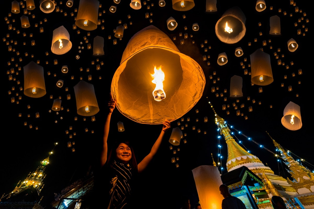 People release giant lanterns into the sky as a symbol of letting go the bad and sins in Yi Peng festival