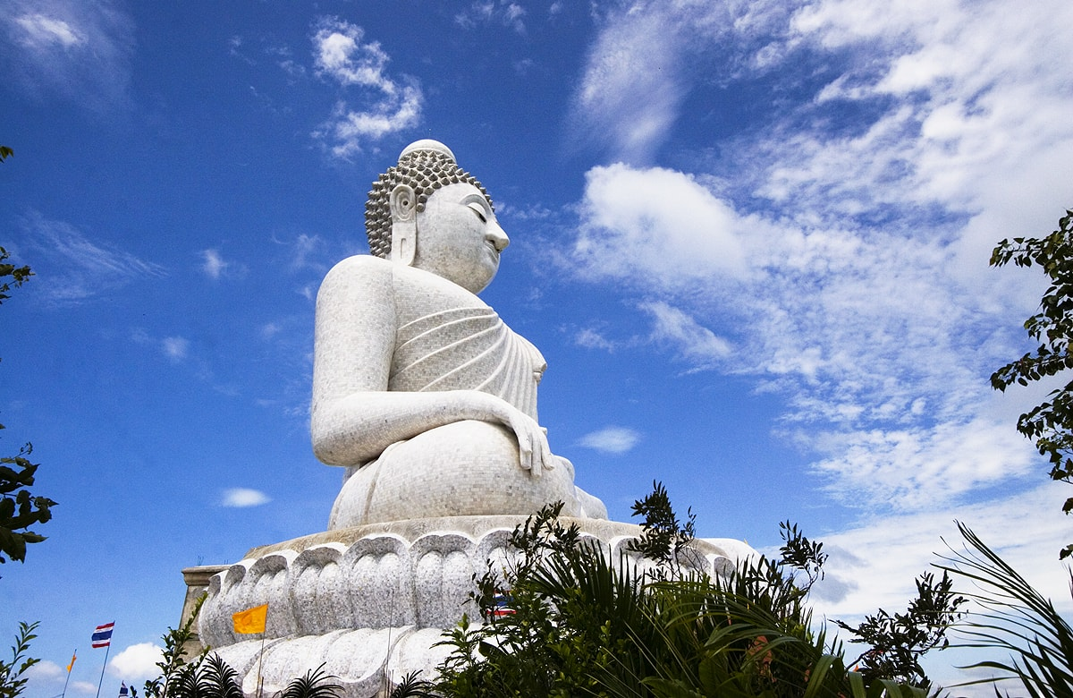 The giant statue is covered by Burmese white jade marble