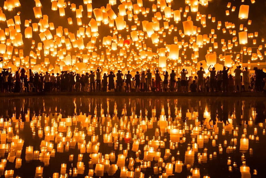 Thousands of lanterns are drifting in the sky. They offer a memorizing image of Chiang Mai