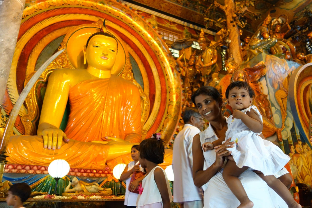 Local people go to the temple on the Vesak festival