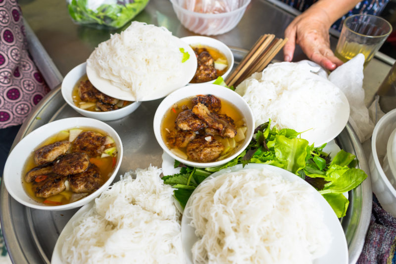 Dip the noodles into the sauce, add fresh veggies and chillies and there you have a perfect-looking bowl of Bun Cha