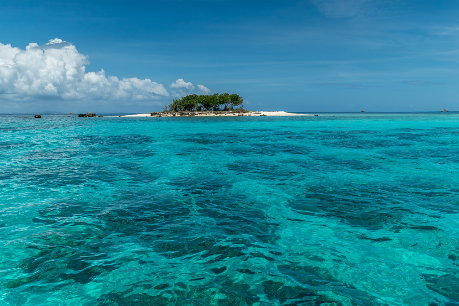 It contains white beach paradise islands that are untouched by humans.