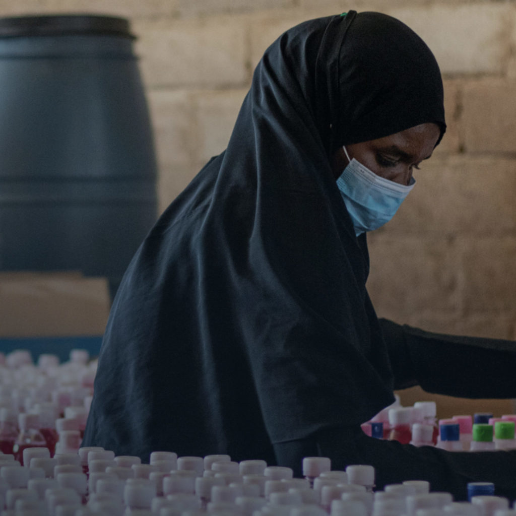 Woman organizing COVID vaccine supplies.