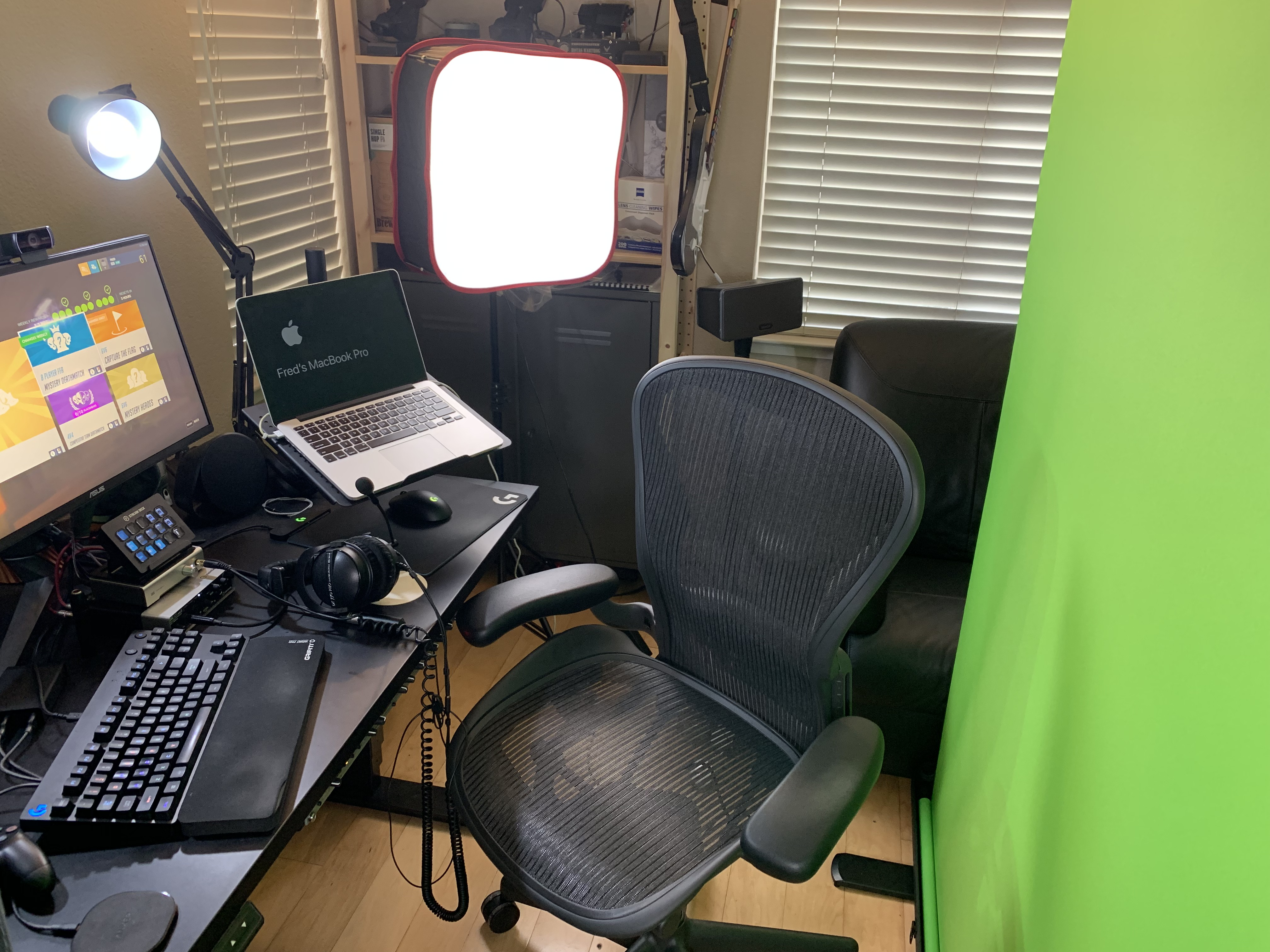 computer, green screen, cameras, and lights