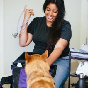 Asia Lewis Vet Assistant with dog patient