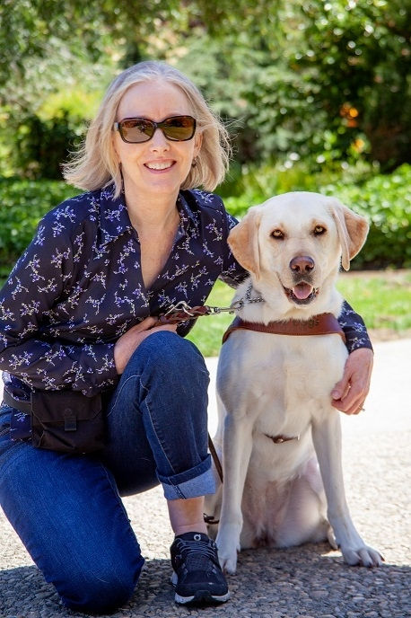 Ann Ulibarri and her guide dog Woon